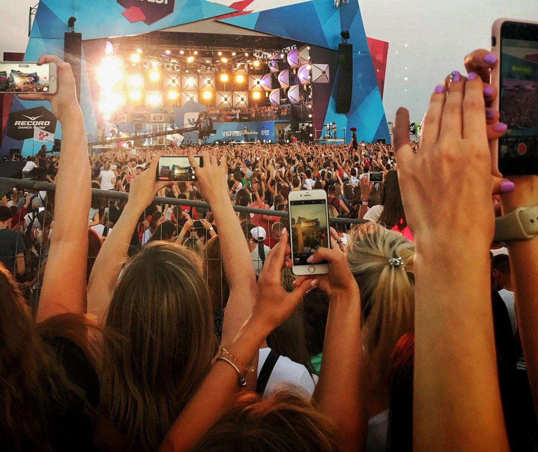 phones recording a festival