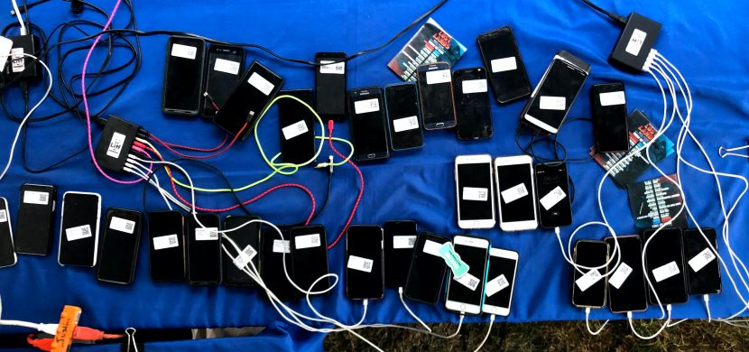 Phones on a Table with Labels